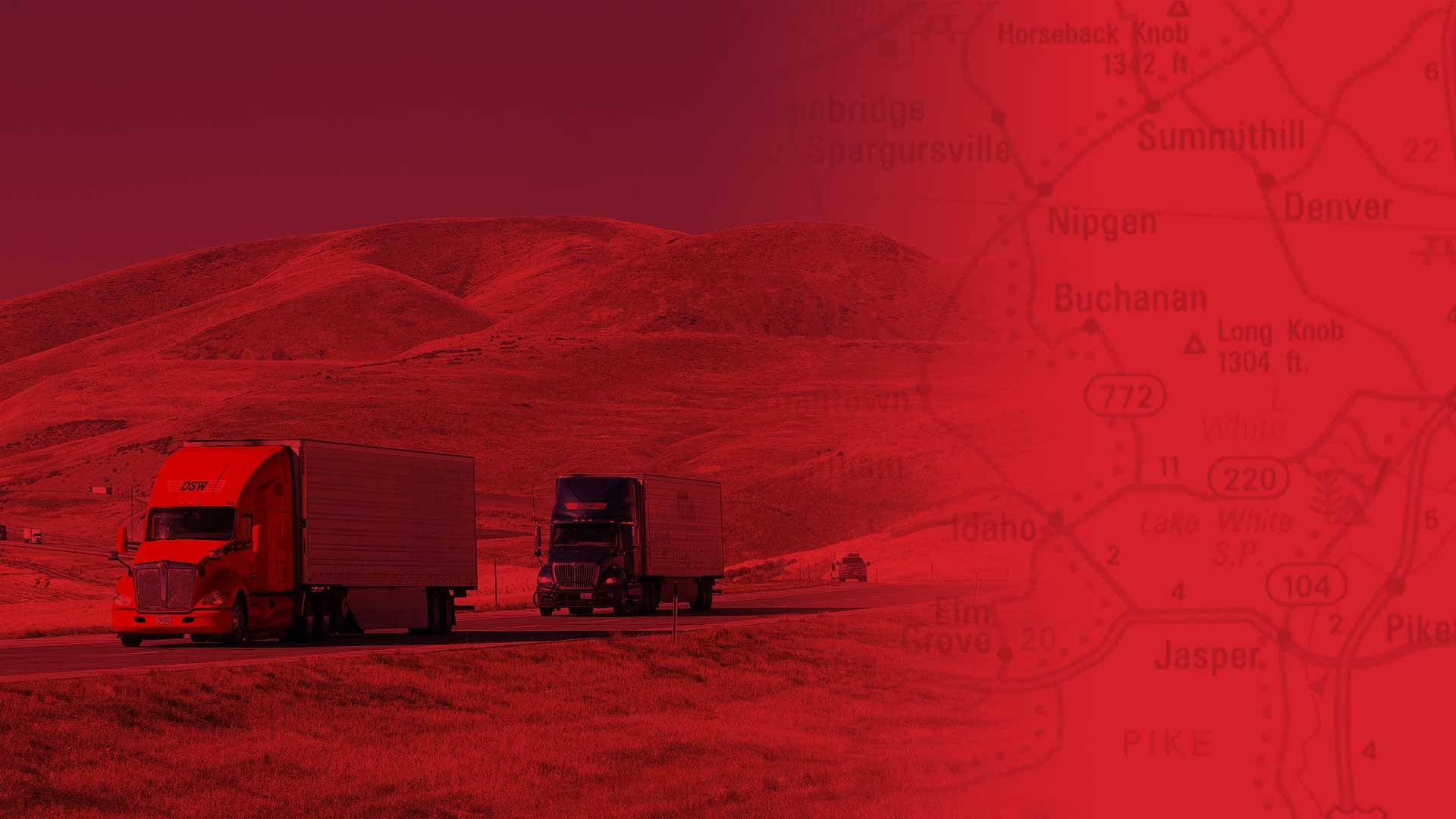 A red map with two semi-trucks driving on the highway